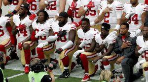 Mandatory Credit: Photo by AP/REX/Shutterstock (9101661f) Members of the San Francisco 49ers kneel during the national anthem as others stand prior to an NFL football game against the Arizona Cardinals, in Glendale, Ariz 49ers Cardinals Football, Glendale, USA - 01 Oct 2017